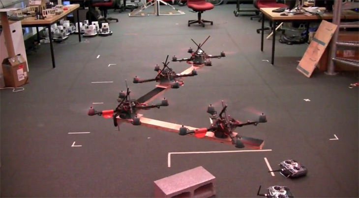 Control of multiple quadrotor robots to cooperatively transport a payload